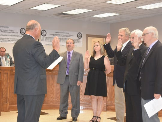 Sumner County Clerk Bill Kemp (left) swore in Sumner County Board of Education members Tim Brewer, Sarah Andrews, Jim Hawkins, Ted Wise and Glen Gregory at a study session meeting on Tuesday, Sept. 6.