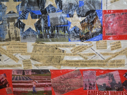 Horseheads High School students used newspaper clippings and images from around the time of the Sept. 11, 2001 attacks to create a flag that hangs on one of the school's walls.