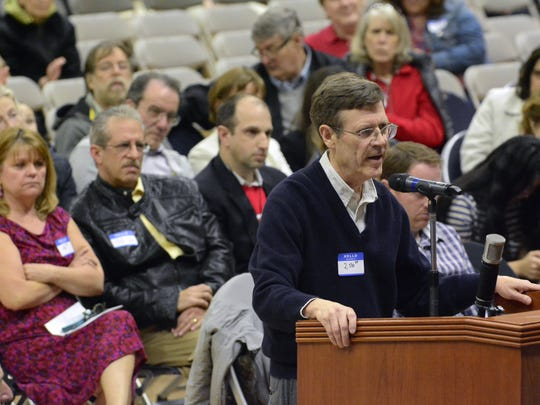 A hearing was held on Wednesday at Brookdale Community College in Lincroft regarding a proposed JCP&L power line project that will affect Monmouth County residents. Robert Billings of Middletown expresses his concerns during the hearing.