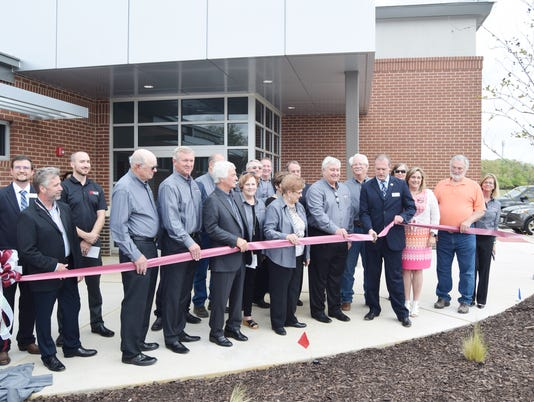 636588066287522421-ribbon-cutting.jpg