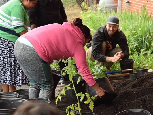 Bounty & Soul participants fill containers with growing medium at last year's Community Dig Day