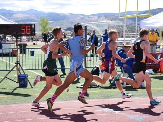 Boys compete in the 4x800 relay Saturday at Carson.