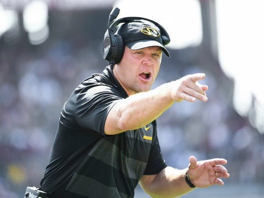 Missouri coach Barry Odom reacts on the sideline during