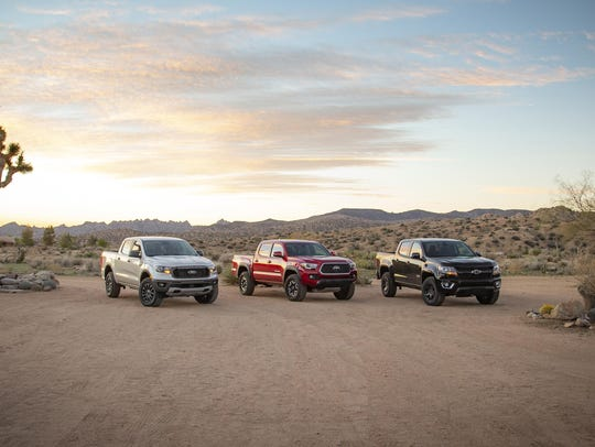 The Chevrolet Colorado, left, Ford Ranger and Toyota