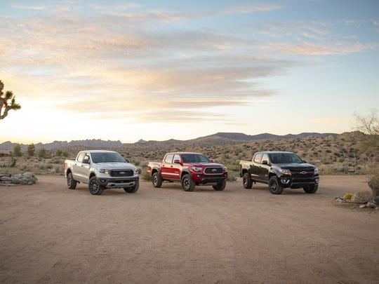 The Chevrolet Colorado, left, Ford Ranger and Toyota Tacoma