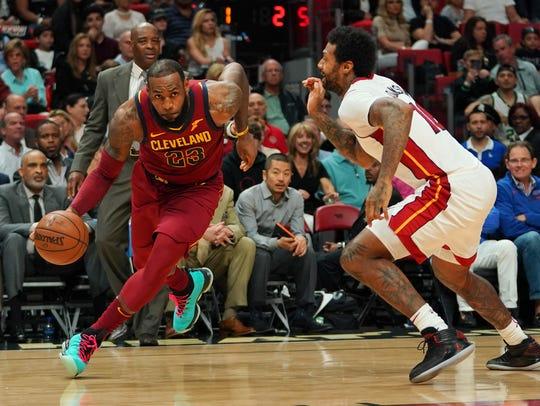 Cleveland Cavaliers forward LeBron James (23) drives