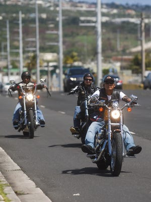 Members of the Pinoy Riders ride together down Army Drive in Dededo on June 26.
