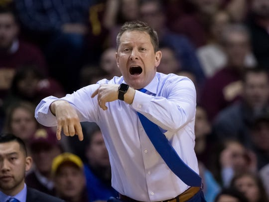 Niko Medved, Drake's first-year coach, yells instructions to his team during a Dec. 11 game at Minnesota. Medved was a popular CSU assistant under Tim Miles and spent four seasons as the head coach at Furman before taking the job at Drake last spring.