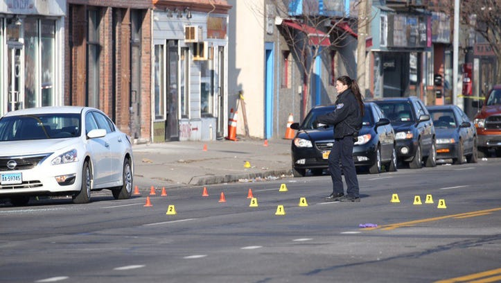 Police investigate at the scene of the mass shooting.