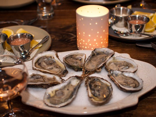 Blue pointe oysters with a cider mignonette, part of