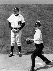Gov. William Milliken throws the first pitch at the 1969 Opening Day game at Tiger Stadium.