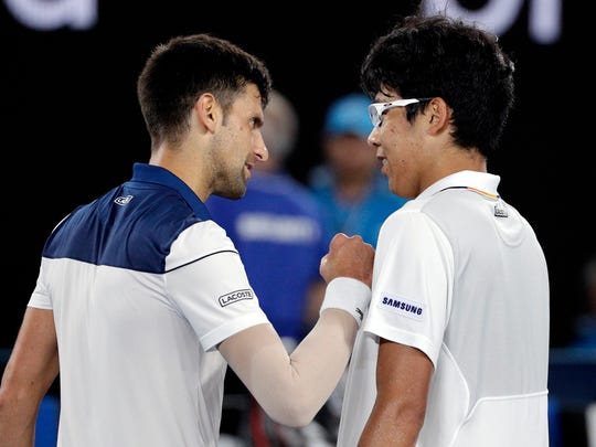 South Korea's Chung Hyeon, right, is congratulated