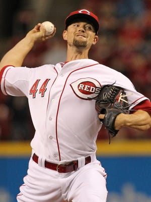 Reds starting pitcher Mike Leake delivers during the first inning of the Opening Night game against the Pittsburgh Pirates.