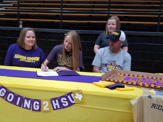 Rider senior Karlea Ritchie signed a letter of intent to play basketball and run track at Hardin-Simmons on Monday in Rider Fieldhouse.