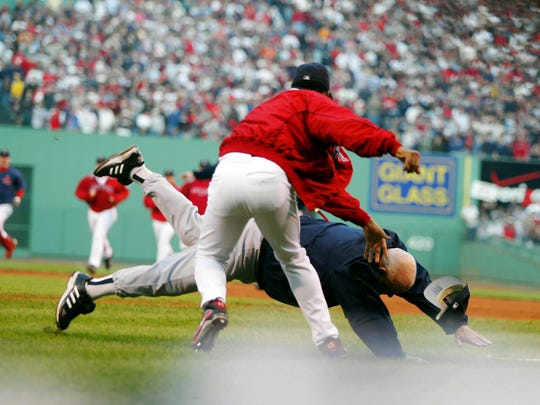 In this Oct. 11, 2003 file photo, New York Yankees coach Don Zimmer is thrown to the ground by Boston Red Sox pitcher Pedro Martinez.