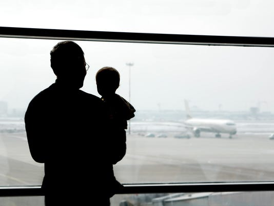 father and son looking at airplanes