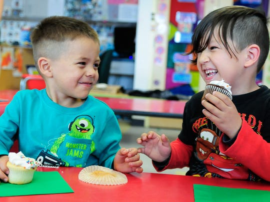 "Jardin de los Niños students Josiah Chavez, 4, left, and Santiago Medrano, 4, enjoy cupcakes Thursday after singing, ""Happy Birthday"" to 10-year-old Lillyanna Martinez."