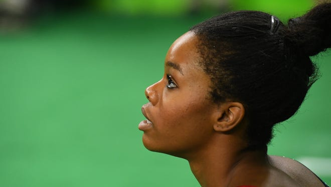 Gabby Douglas (USA) looks on during women's gymnastic qualifications Aug. 7, 2016, in the Rio 2016 Summer Olympic Games at Rio Olympic Arena.