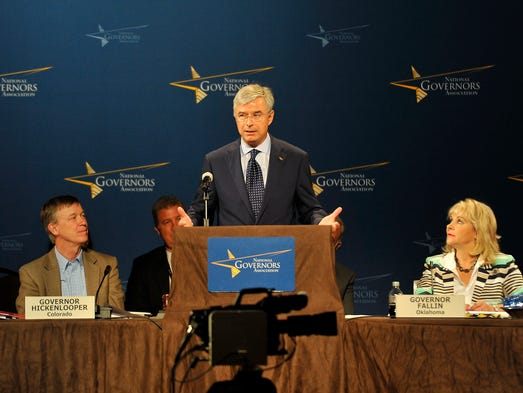 Best Buy CEO Hubert Joly, center, speaks as Oklahoma Gov. Mary Fallin, right, and Colorado Gov. John Hickenlooper look on during the closing session of the NGA conference at the Omni Hotel in Nashville, Tenn., Sunday, July 13, 2014.
