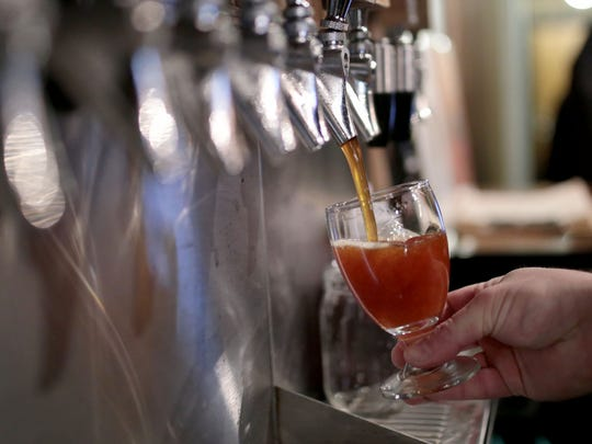 A beer is being poured at Batch Brewing Company in