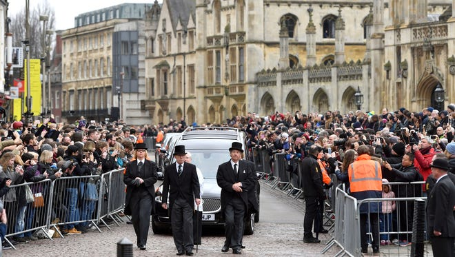 The hearse containing Professor Stephen Hawking arrives at University Church of St Mary the Great as mourners gather to pay their respects, in Cambridge, England, March 31.