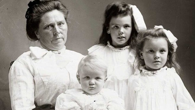 Belle Gunness with her three children Philip, Myrtle and Lucy.