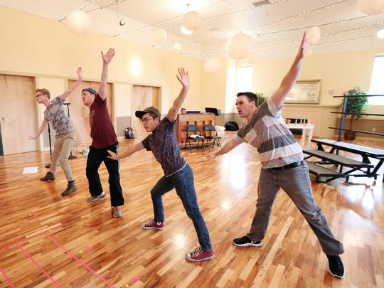 """Clark Kinkade, left, Carl Glenn, Nicholas Martinez and Taylor Murphy Hale rehearse a scene for Enlightened Theatrics' production of """"Plaid Tidings"""" on Tuesday, Nov. 15, 2016, at the Grand Theatre in downtown Salem."""