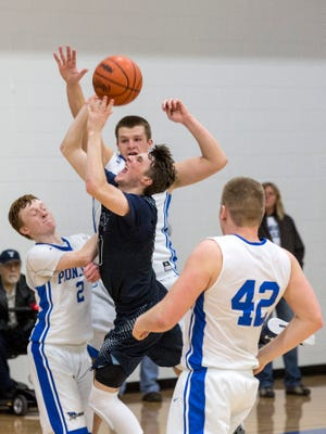 Yale senior Cody Kegley scores the game-winning shot over a host of Cros-Lex defenders during a district final basketball game Friday, March 11, 2016 at Cros-Lex High School.