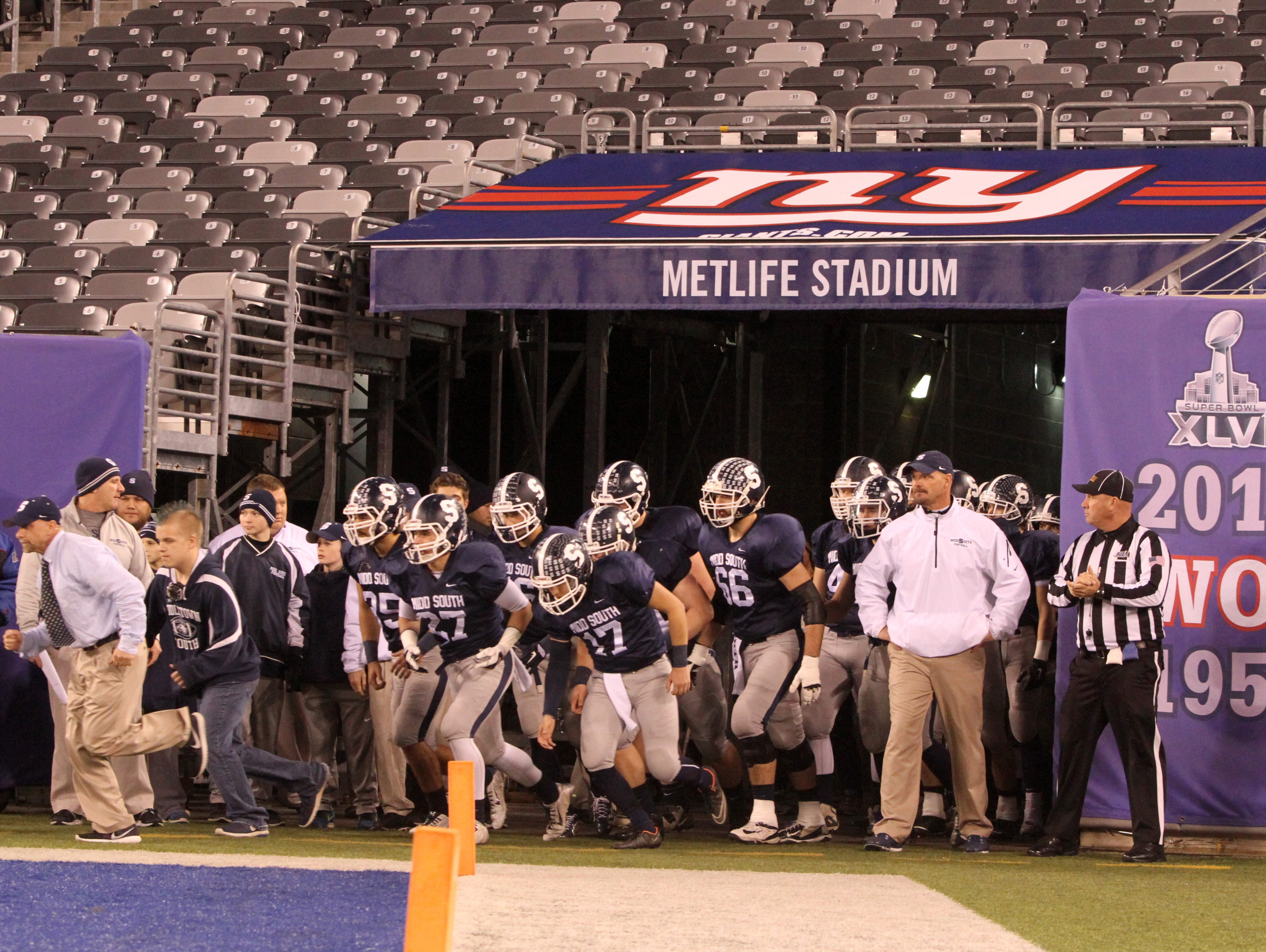 Middletown South High School football team runs onto the field to play against Phillipsburg High School during the North 2 Group IV game of the 2015 NJSIAA/MetLife Stadium High School Football Championships at MetLife Stadium in East Rutherford, NJ Saturday December 5, 2015.