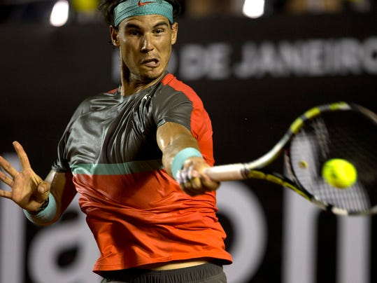 Rafael Nadal, of Spain, returns the ball to Albert Montanes, of Spain, at the Rio Open tennis tournament in Rio de Janeiro, Brazil, Thursday, Feb. 20, 2014. (AP Photo/Silvia Izquierdo)
