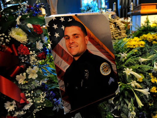 Metro Police Officer Andrew David Nash was honored with a Mass of the Resurrection at St. Edward Church Friday April 25, 2014, in Nashville, Tenn.