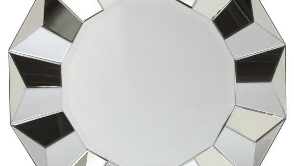 A faceted Portico mirror that would make a dramatic statement over a mantel or in an entryway.