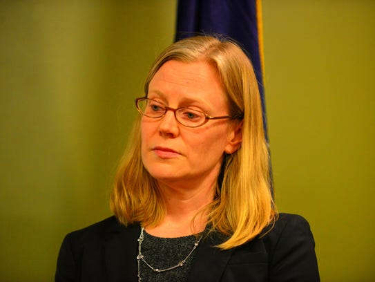 Acting U.S. Attorney for Vermont Eugenia Cowles listens