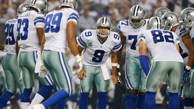 Sep 28, 2014: Dallas Cowboys quarterback Tony Romo (9) calls the play in the huddle against the New Orleans Saints at AT&T Stadium.