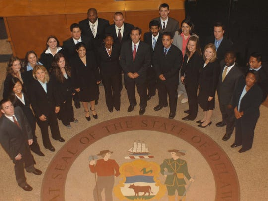 The official photo of the 2007 summer law clerks at the Delaware Attorney General's Office. Sarita Wright is in the center standing next to Attorney General Beau Biden.