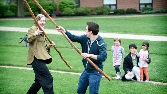 Lebanon Valley College Spiritual Life sponsored a May Day celebration Sunday, May 1, 2016 on the Social Quad on campus. Celebrations marking May Day are a tradition that dates back to the turn of the century, 1900. Carl Bright-Walk and Alex Jonovich battle for spectators in a scene from Robin Hood. Other events included dancing and music.