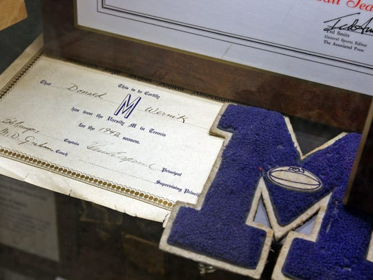 Metuchen High School is researching an inaugural Hall of Fame induction class. This is Donald Wernik's high school letter on display in a trophy case at the school. Wernik, is a former Metuchen Mayor and Middlesex County Freeholder  (Accomplished Professional, Class of 1943)
