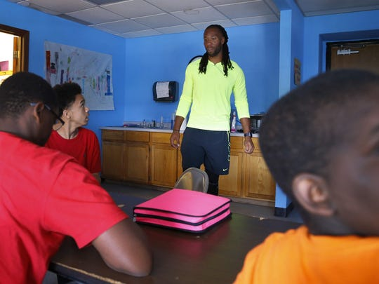 Larry Fitzgerald visits the Sabathani Community Center on July 23 in Minneapolis, MN.