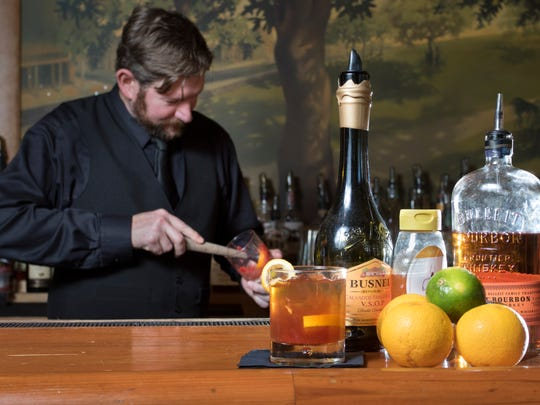 Bartender Chris Vonbehren muddles fruit to prepare a 23 Star Salute cocktail at Jackson's Steakhouse in Pensacola on Friday, February 24, 2017.