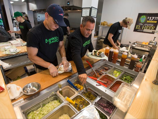 John Pesce (left), crew member, and co-founder Paul Altero prepare food at Bubbakoo's Burritos in Howell.