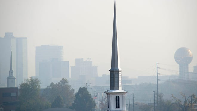 "The steeple of Greater Mount Moriah FBH Church is pictured against the hazy skyline Nov. 14, 2016, in Mechanicsville. As a result of forest fire smoke, the Knox County Health Department said air conditions are on the verge of again reaching a ""code red"" meaning air quality has reached ""Unhealthy"" level."
