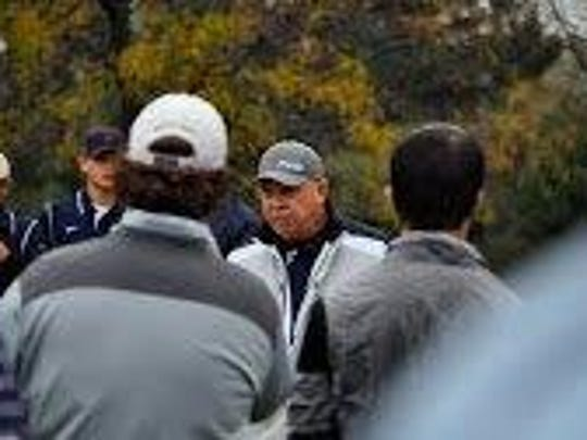Schoolcraft men's golf coach Paul Brown gives instruction