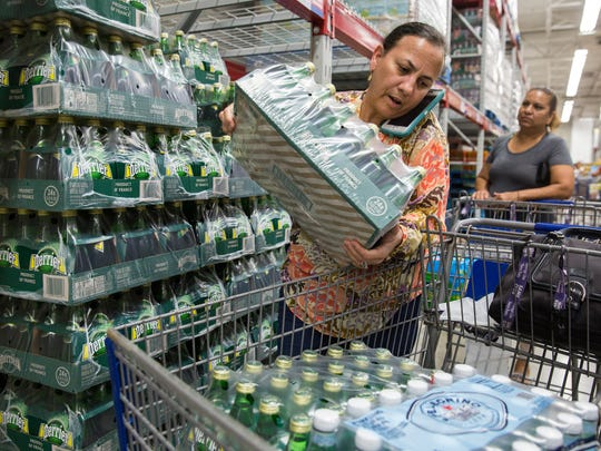 With no bottled water left available, Eva Huerta instead stocked up on sparkling water at the Sam's Club in North Naples on Tuesday, Sept. 5, 2017. On Monday, Florida Gov. Rick Scott issued a state of emergency for Florida.