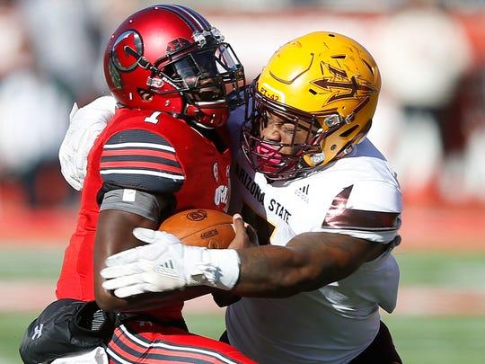 Arizona State linebacker DJ Calhoun, right, sacks Utah