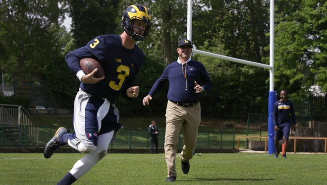 Michigan coach Jim Harbaugh practices a drill with quarterback Wilton Speight during the Wolverines first practice in Rome at Giulio Onesti Training Center on Thursday, April 27, 2017.