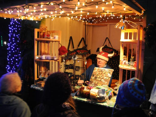 Artisans show off their wares including artwork, food