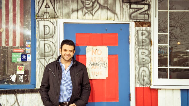 "This undated photo provided by the Travel Channel shows host Adam Richman of the new series, ""Man Finds Food"" in Atlanta. The channel said Tuesday, July 1, that Richman's show has been postponed indefinitely but didn't explain why. ""Man Finds Food"" was to debut Wednesday."