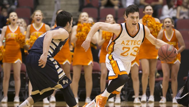 Corona del Sol's Alex Barcello (23) drives down court against Desert Vista's David Powell (3) during the Division I State Final game at Gila River Arena in Glendale on March 2, 2015.