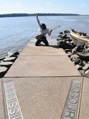 At the confluence of the Missouri and Mississippi rivers, Kris Laurie struck a pose. It took over four months to reach this historic spot.