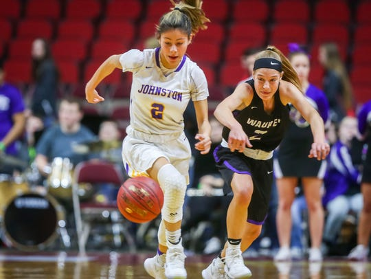 Johnston's(2)Maya McDermott drives past Waukee's(2)